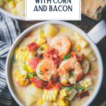 Close overhead shot of a bowl of shrimp corn soup with text title overlay