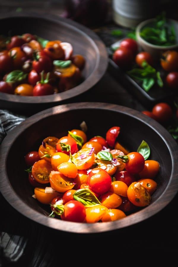 Close side shot of a bowl of tomato basil salad