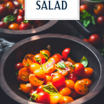 Bowl of tomato salad with text title overlay