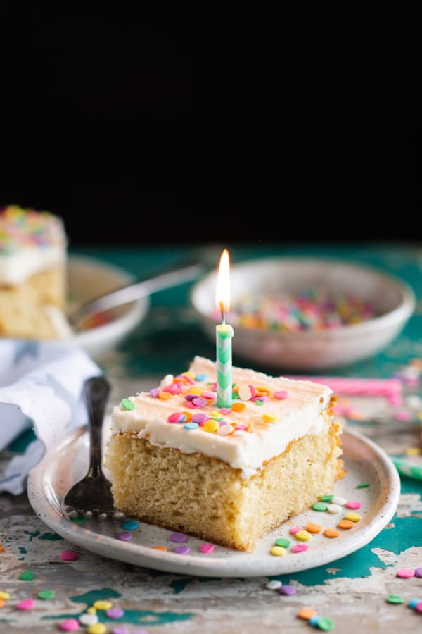 Slice of vanilla cake with a candle in it