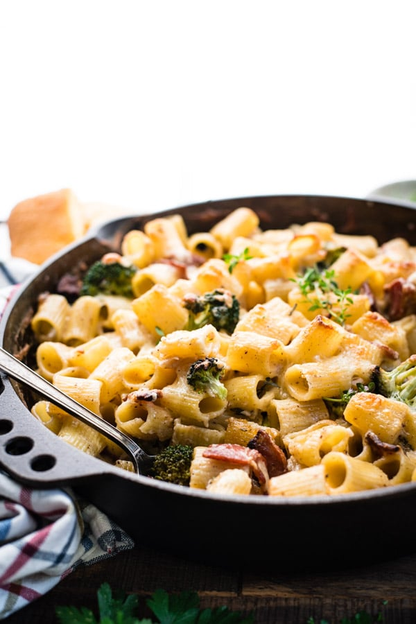 Close up front shot of a broccoli pasta bake in a pan