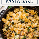 Overhead image of a cheesy pasta bake with text title box at top
