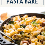Close up side shot of a rigatoni pasta bake with text title box at top