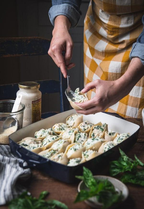 Process shot showing how to make chicken stuffed shells recipe
