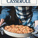 Holding chicken rice casserole with text title box at top
