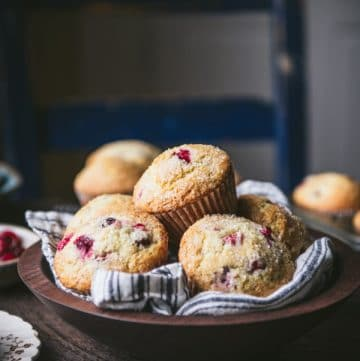 Wooden bowl of the best cranberry muffin recipe on a table.