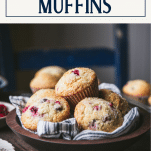 Cranberry muffins in a wooden bowl with text title box at top