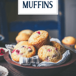Basket of fresh cranberry muffins with text title overlay
