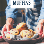 Hands serving a bowl of cranberry orange muffins with text title overlay