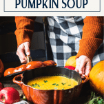 Hands serving a pot of creamy pumpkin soup with a text title box at top