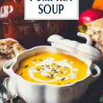 Close up side shot of creamy pumpkin soup in a white bowl with text title overlay