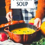 Hands serving a pumpkin shaped pot of pumpkin soup with text title overlay