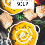 Overhead shot of creamy pumpkin soup in bowls with text title overlay