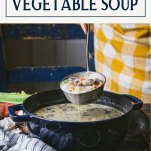Ladle full of vegetable soup with text title overlay
