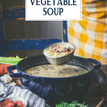 Ladle full of creamy vegetable soup with text title overlay