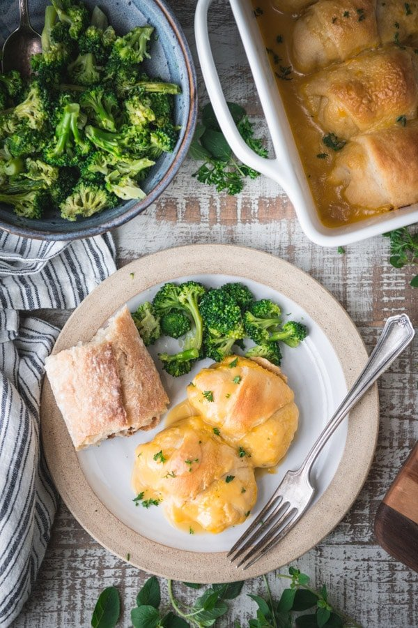 Overhead shot of a plate of chicken crescent rolls with a side of broccoli