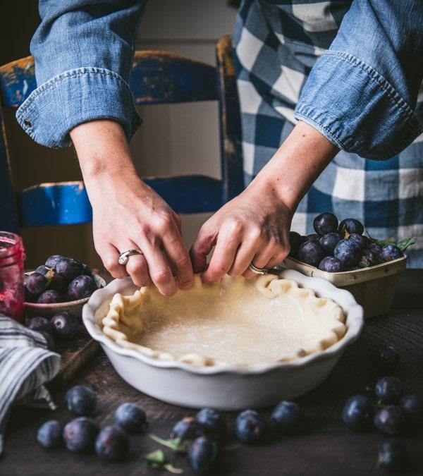Crimping edges of a pie crust.