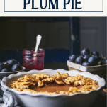 Side shot of damson caramel pie on a table with text title box at top