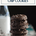 Stack of soft and chewy double chocolate chip cookies with text title box at top