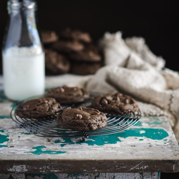 Double chocolate chip cookies on a round cooling rack