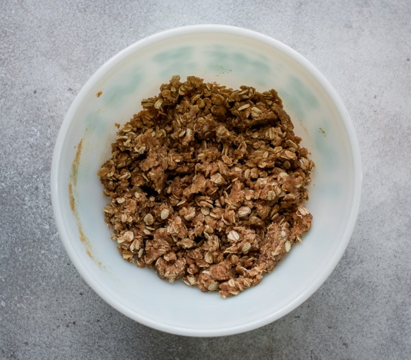 Oat streusel crumb topping in mixing bowl.