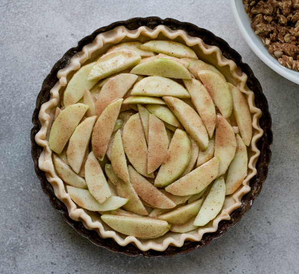Apple filling in an unbaked pie crust.