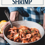 Hands holding a bowl of garlic butter shrimp with text title overlay