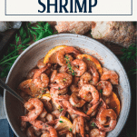 Overhead shot of lemon garlic butter shrimp with text title box at top