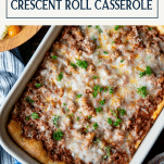 Overhead image of a pan of pillsbury crescent roll casserole with text title box at top