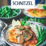 Plate of pork schnitzel with mushroom gravy with text title overlay
