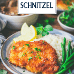 Plate of pork schnitzel with text title overlay