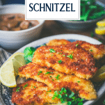 Close up side shot of a tray of pork schnitzel with text title overlay