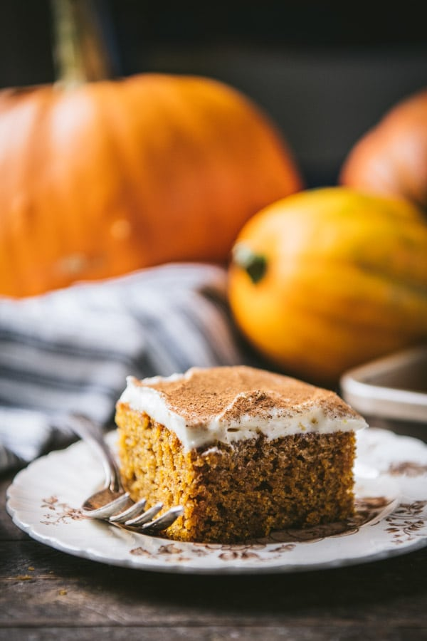 Side shot of homemade pumpkin bars with cream cheese frosting.