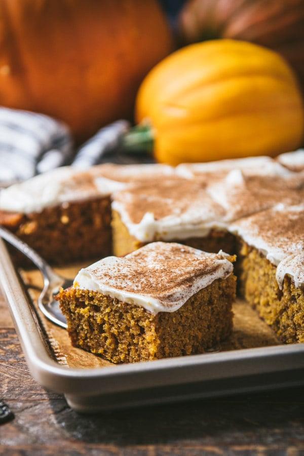 Close up side shot of a pan of pumpkin dessert bars.