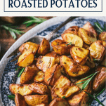 The best roasted potatoes recipe on a plate with text title box at top