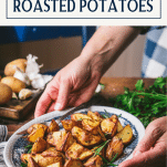 Hands serving a plate of rosemary roasted potatoes with text title box at top