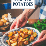 Hands holding a plate of rosemary roasted potatoes with text title overlay