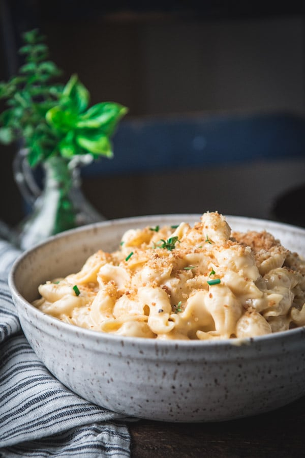 Close side shot of a bowl of homemade shells and cheese