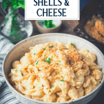 Bowl of shells and cheese with text title overlay