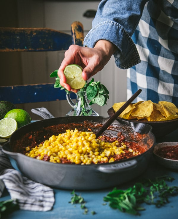 Adding lime juice to a skillet