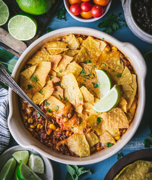 Overhead image of the best taco casserole recipe served on a blue table