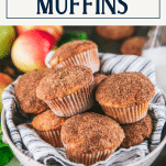 Close up shot of a bowl of grated apple muffins with text title box at top