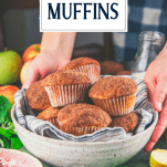 Hands holding a bowl of easy apple muffins with text title overlay