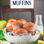 Side shot of apple muffins in a bowl with text title overlay