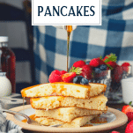 Pouring syrup on a stack of baked pancakes with text title overlay