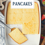 Overhead shot of a pan of baked buttermilk pancakes with text title overlay
