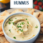 Close up shot of a bowl of the best hummus with text title overlay