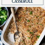 Shredded chicken and stuffing casserole in a white pan with text title box at top