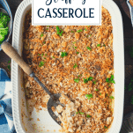 Overhead shot of a white dish full of chicken and stove top stuffing casserole with text title overlay
