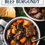 Close overhead shot of a bowl of beef bourguignon with text title box at top